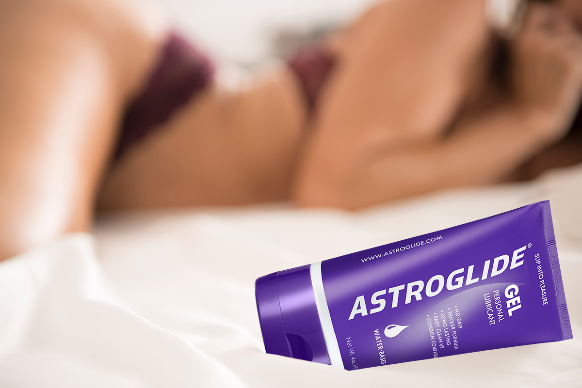 ASTROGLIDE gel lubricant on a bed