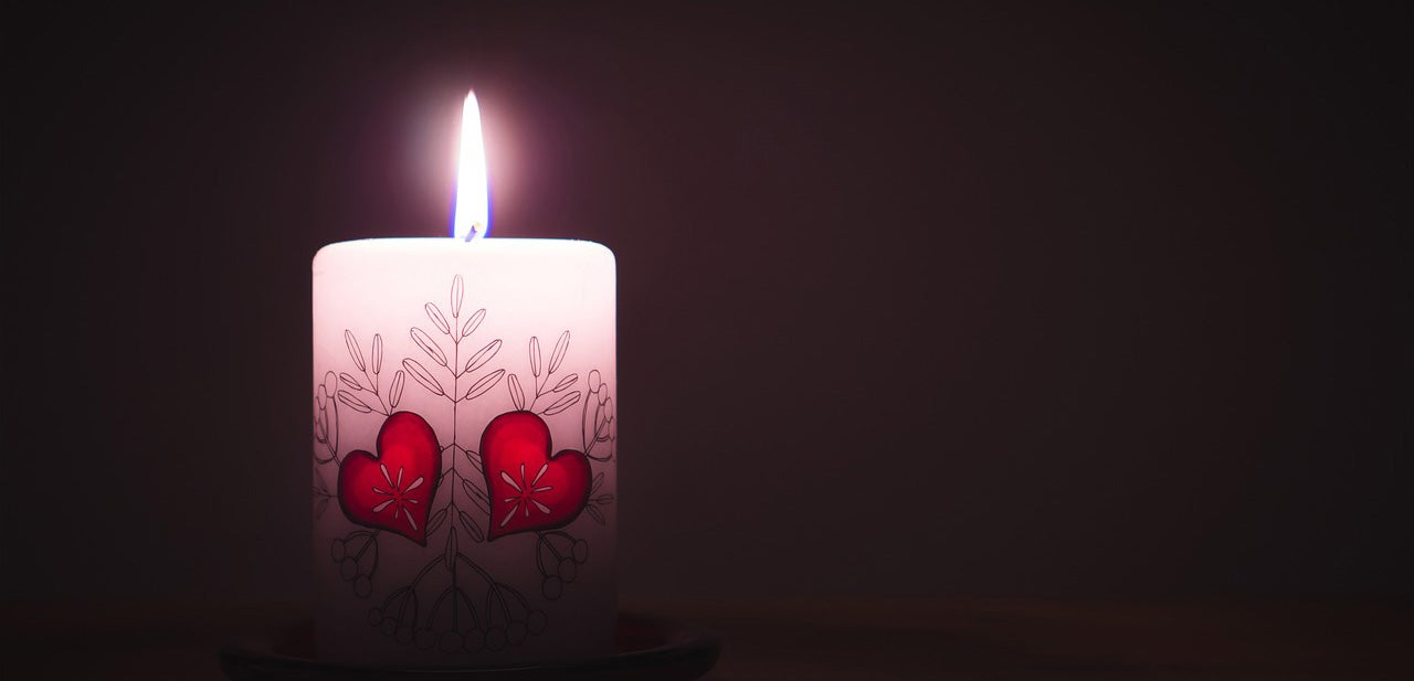 A romantic candle decorated with hearts