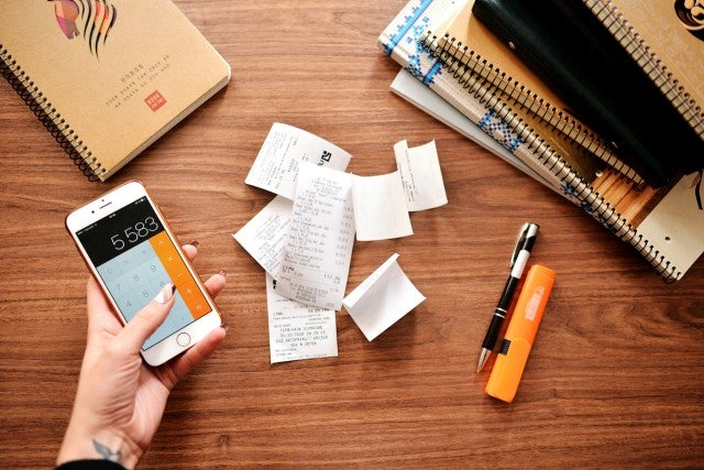 receipts, calculator and notebook.