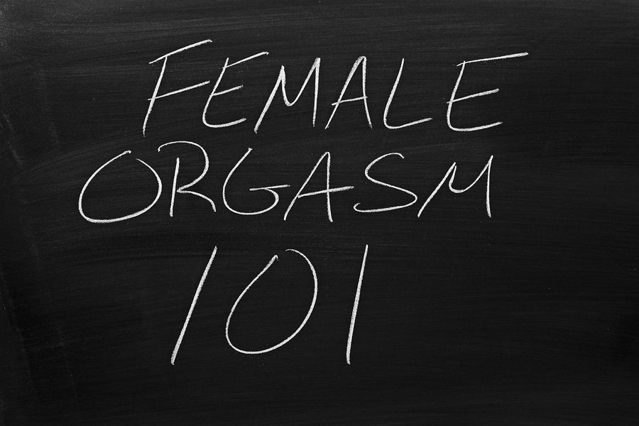 Female Orgasm 101 written on a black chalkboard