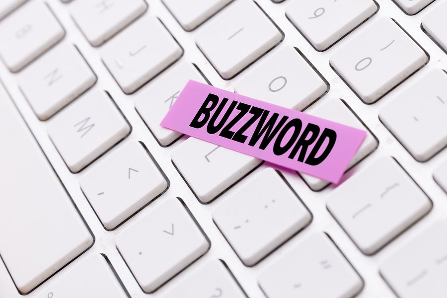 keyboard with cut out word buzzword placed on top of keys.